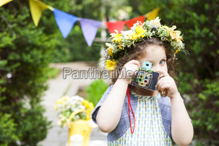 little girl wearing flowers taking a