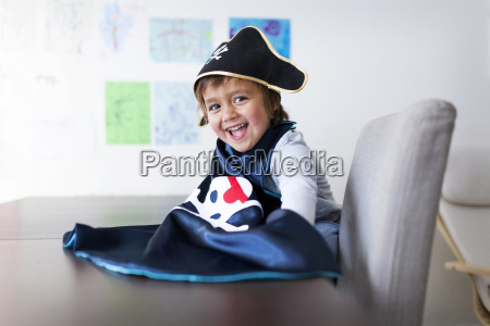 portrait of laughing little boy dressed