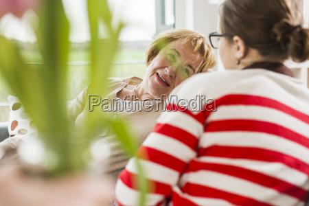 senior woman talking to young woman