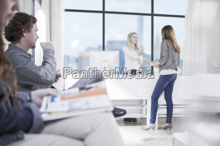 office receptionist talking to guest