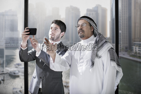 western and middle eastern businessmen discussing