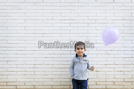 portrait of toddler standing in front