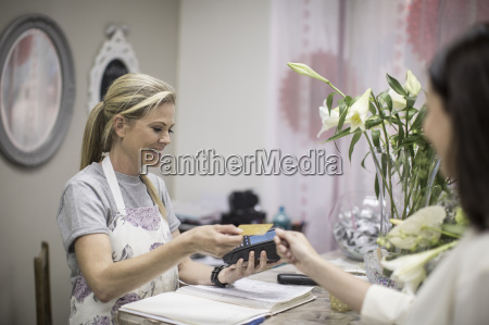 customer paying in flower shop