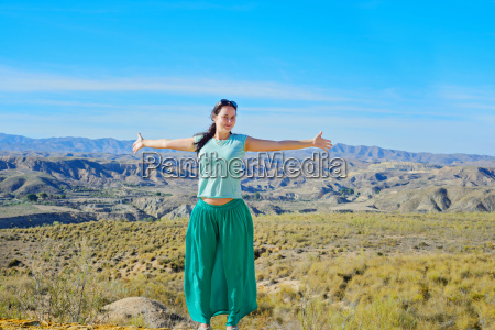 happy woman open arms stand at