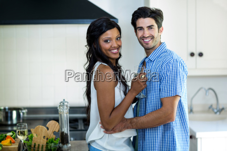 portrait of young couple embracing in
