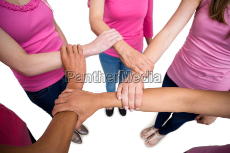 women in pink outfits joining in