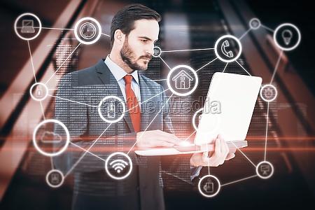composite image of focused businessman using