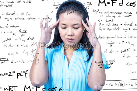 composite image of worried businesswoman holding