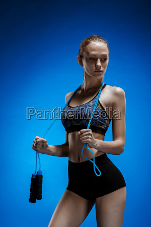 muscular young woman athlete with a