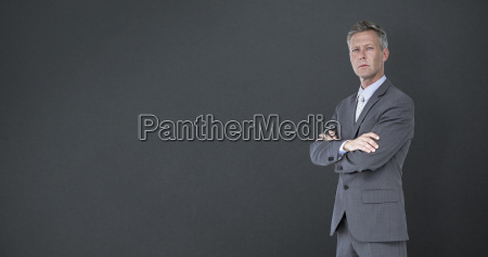 composite image of businessman standing arms