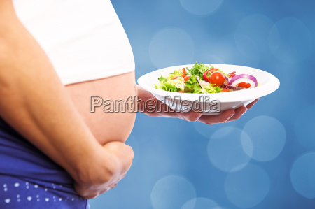composite image of pregnant woman eating