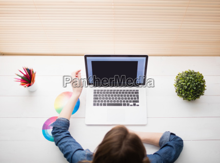 overhead view of businesswoman using laptop