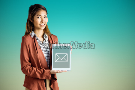 composite image of smiling businesswoman showing