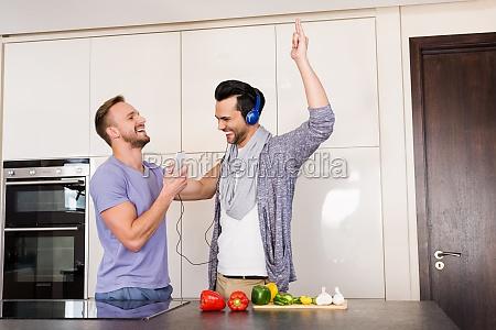 smiling gay couple having fun while