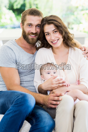 happy parents with their baby in