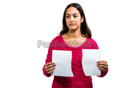 woman holding torn documents