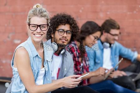 friends sitting on roadside