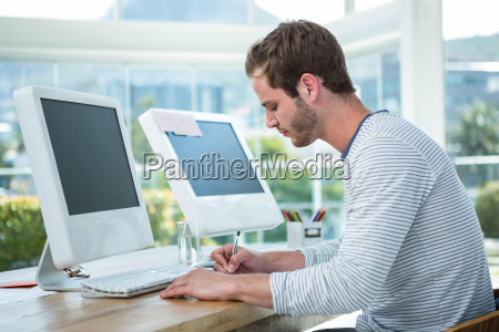 handsome man working on computer and