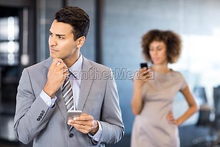 good looking businessman looking away