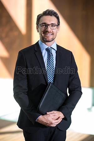 portrait of happy businessman standing in