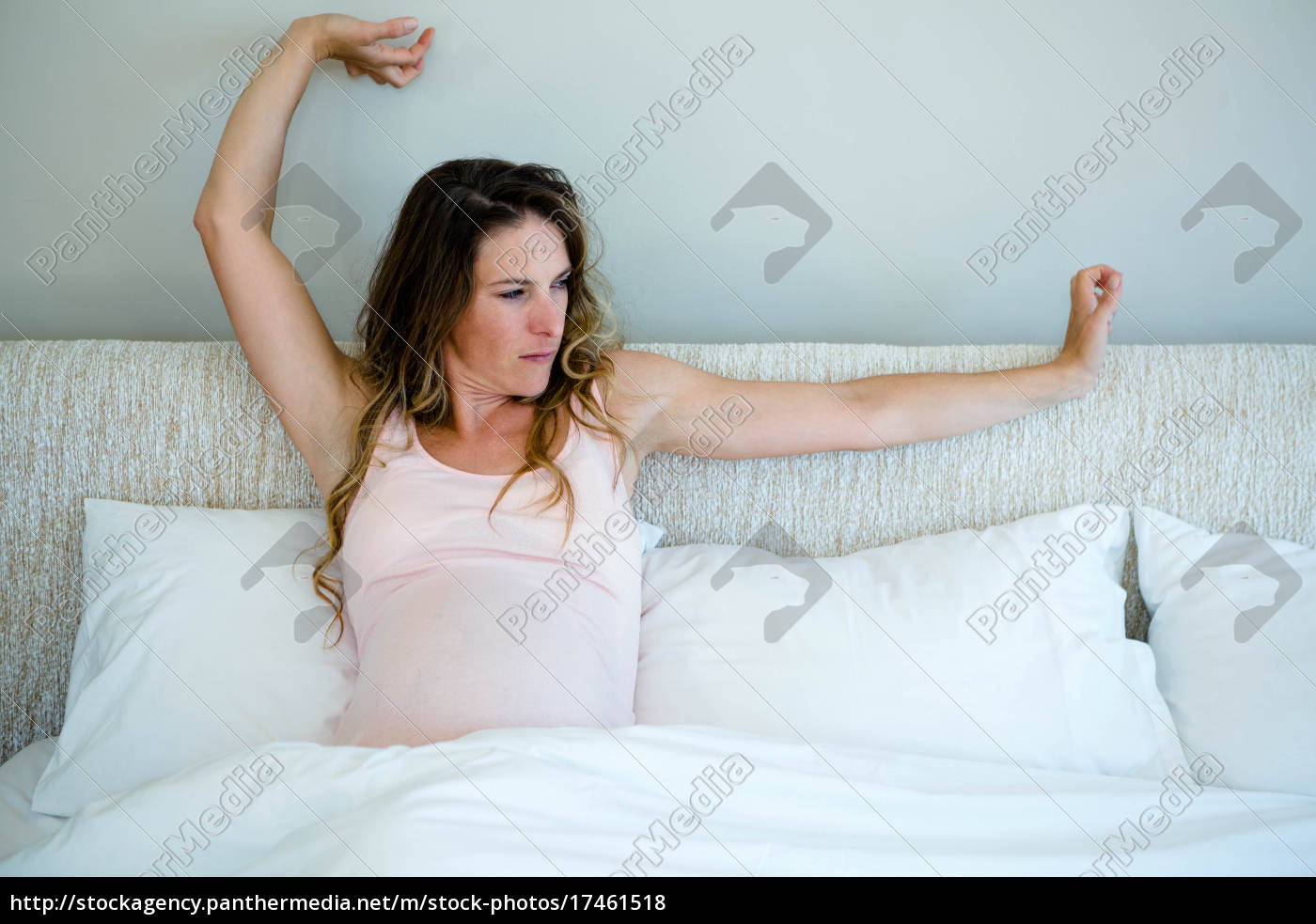 Tired Pregnant Woman In Bed Stretching Her Arms Royalty Free Image 17461518 Panthermedia Stock Agency