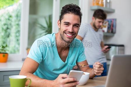 portrait of smart cheerful man using