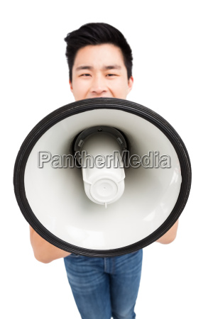 young man shouting on horn loudspeaker