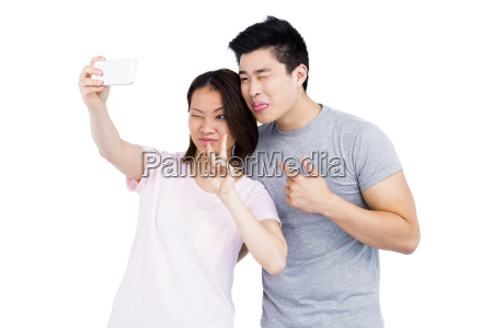 young couple taking a selfie on