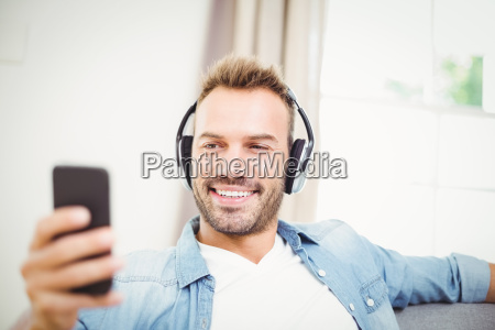 happy man using mobile phone while