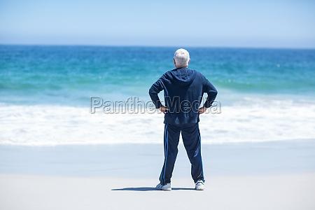 handsome mature man facing the sea