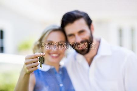 couple holding house key