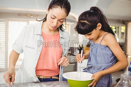 close up of woman preparing food