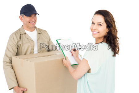 happy delivery man giving package to