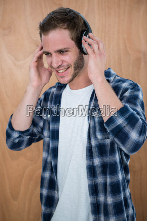 handsome man listening to music with