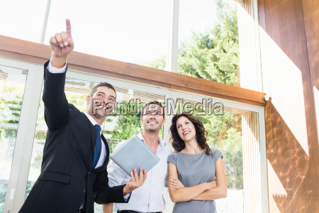 real estate agent showing couple new