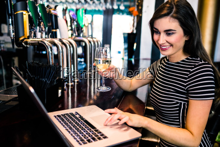 attractive woman using laptop and having