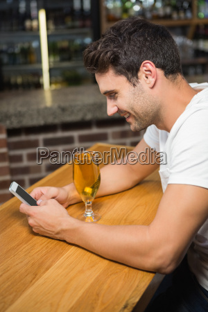 handsome man using smartphone and having