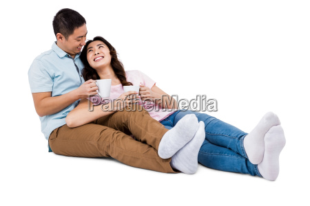happy young couple with cup