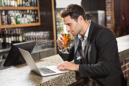 handsome man using laptop and having