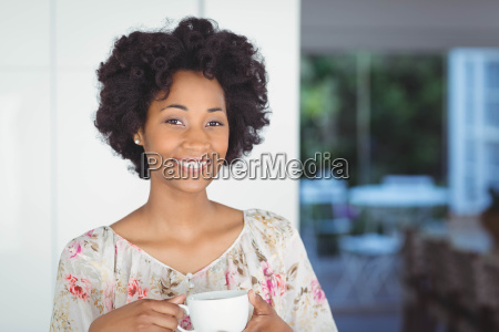 portrait of smiling woman holding white