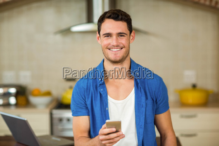 happy young man using smartphone