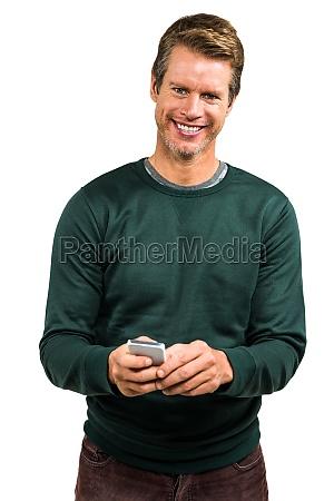 portrait of smiling man using smartphone