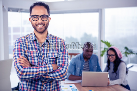 portrait of happy businessman standing with