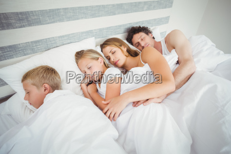 high angle view of family resting