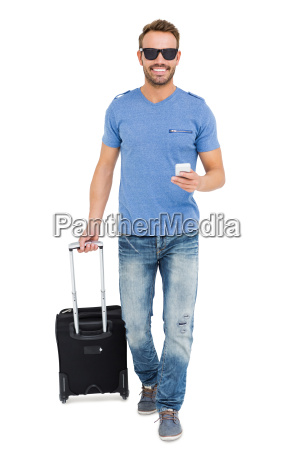 young man with trolley bag and