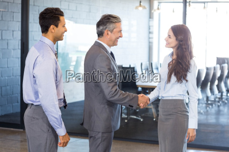 business team interacting in office
