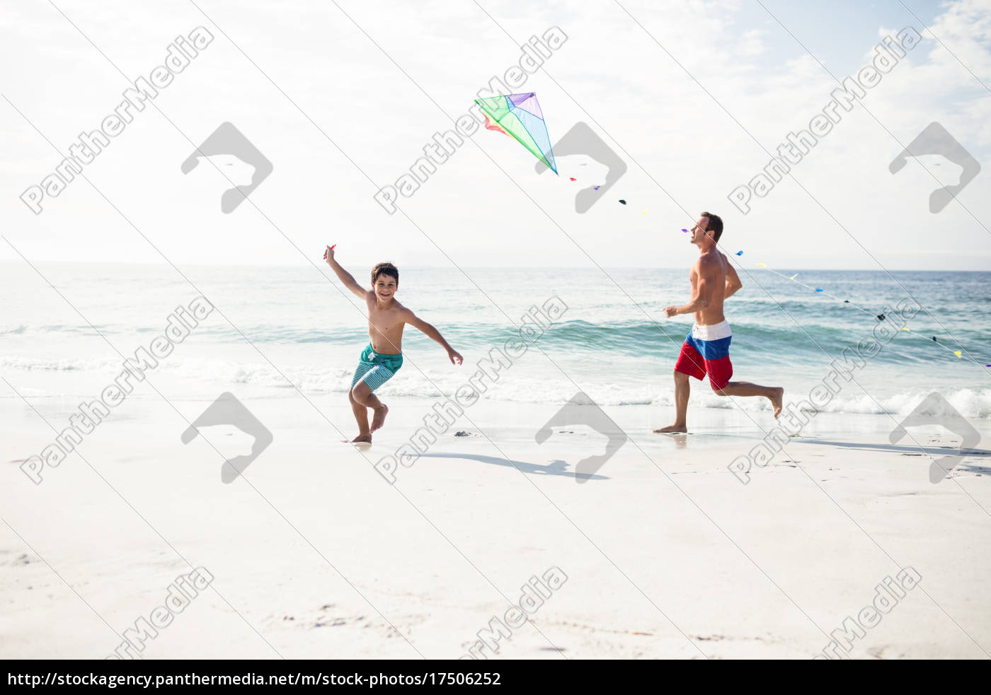father, and, son, playing, with, kite - 17506252