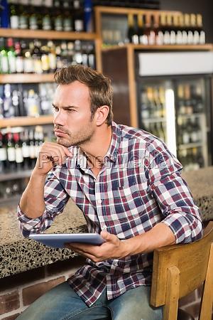 handsome man using tablet computer