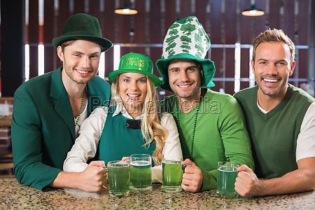 friends wearing st patricks day associated