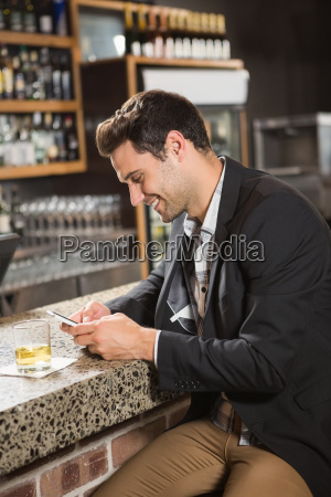 handsome man having a whiskey and